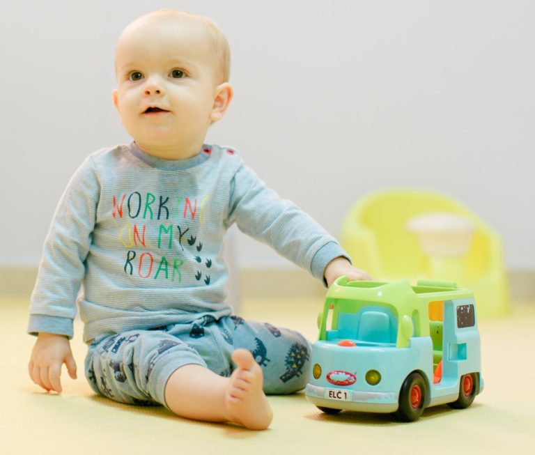 Baby playing with toy truck at a Nursery and Preschool in Abu Dhabi and Dubai