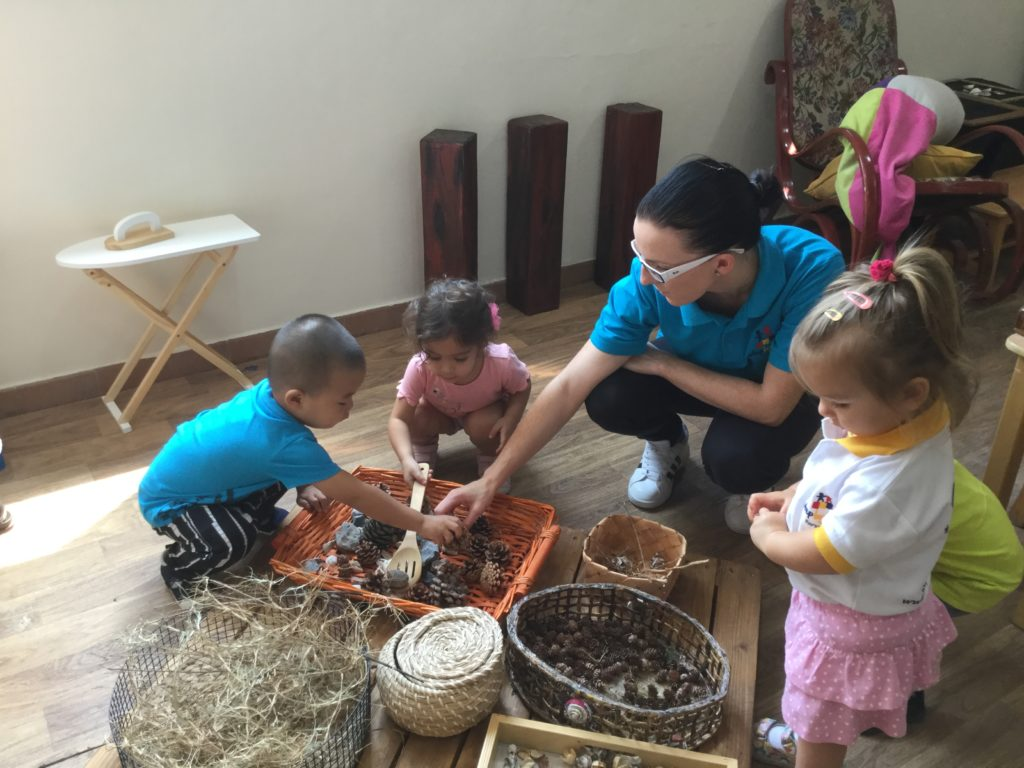 Nursery class playing with nature-based materials