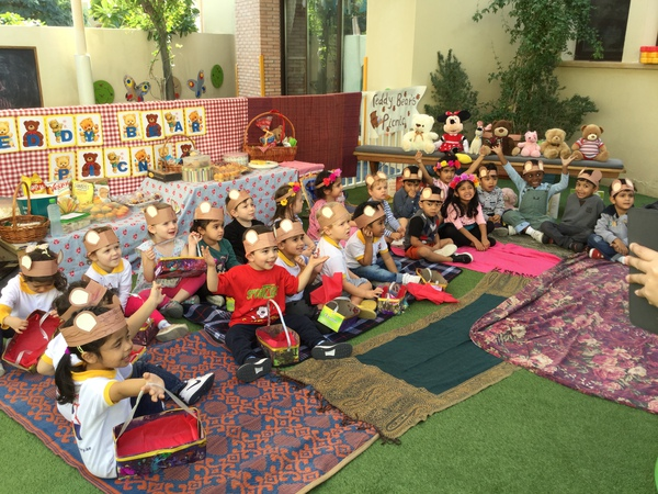 Happy nursery students during a classroom picnic